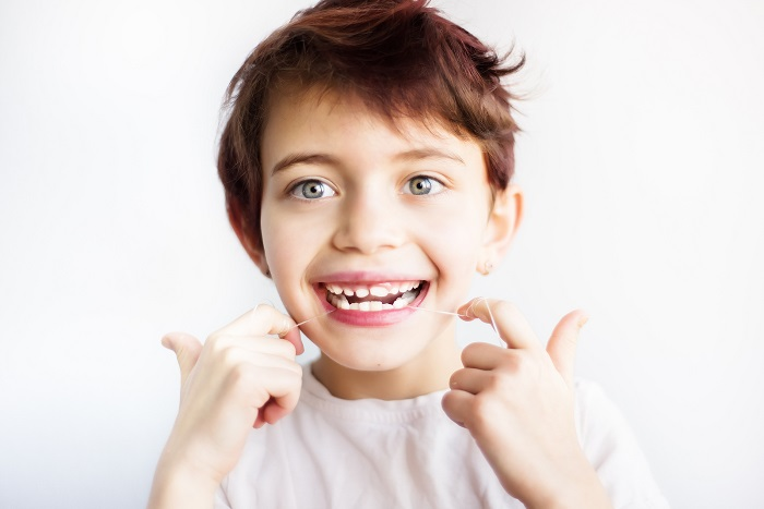 flossing teeth is recommended by pediatric dentists in Frisco by age 6